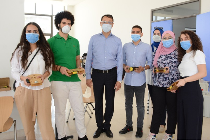 Dr. Ashraf Mansour with university students