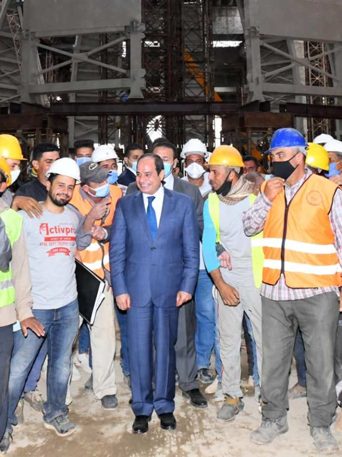 The President Poses for Photo-Op with Workers
