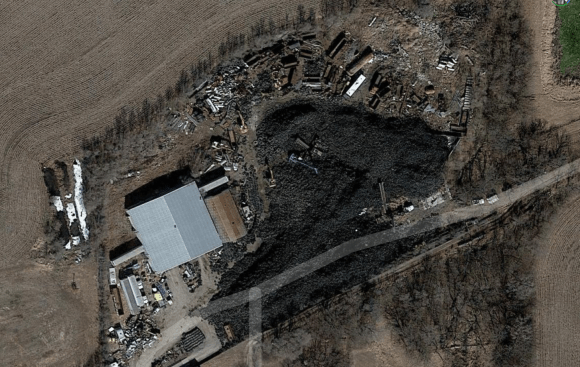 A satellite image shows the sea of over a quarter million tires in Alvo.