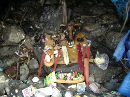 Inside of the sacred oboo. Local people offer food, drink, candies, banknotes, meat etc. to the oboo.