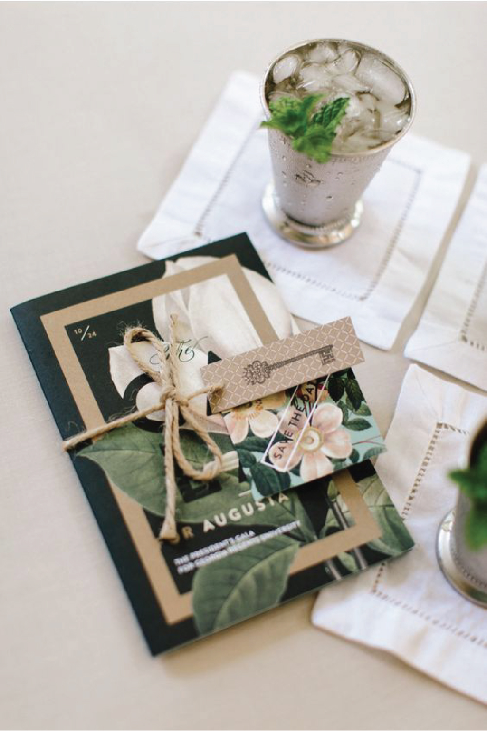 Extravagant invitation with layers, floral, kraft paper & type