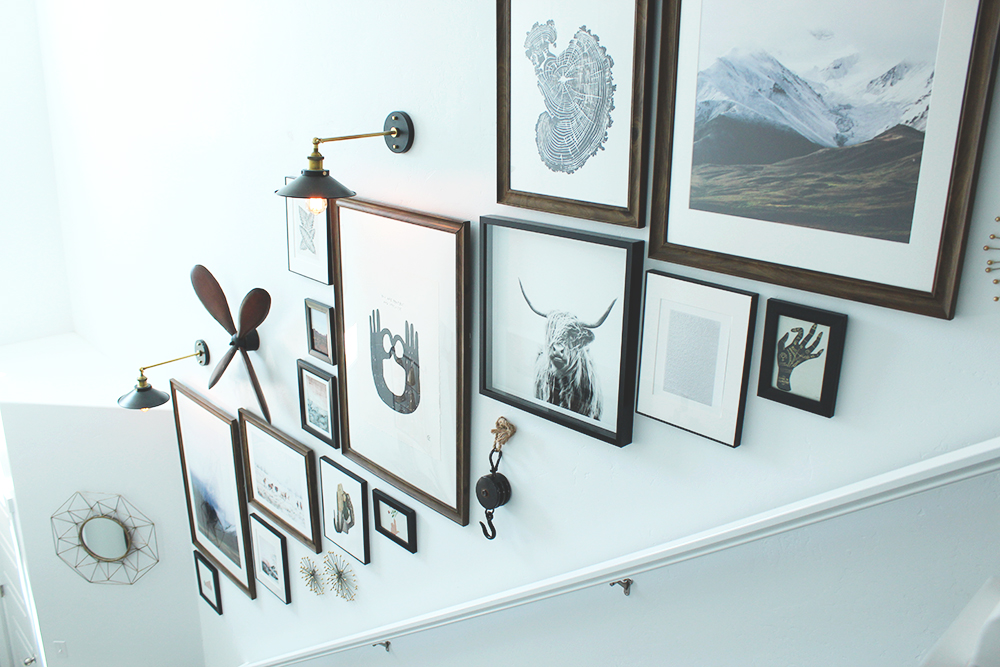 seeking alexi gallery wall after photo with lots of framed artwork in wooden, black, or white frames