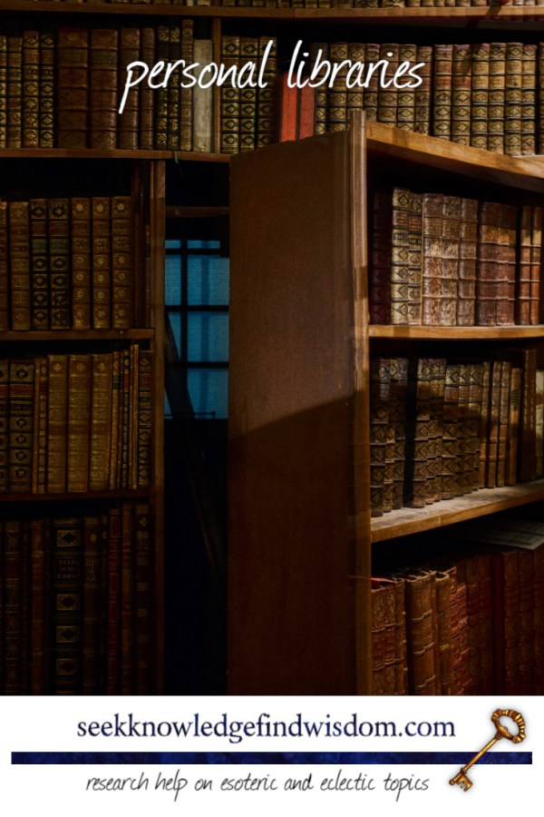 A hidden bookcase opens out, revealing a room behind. The bookshelves are full of leather-bound books.