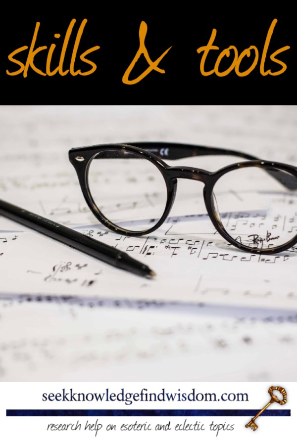 Skills and tools : Glasses and pen resting on sheets of printed music