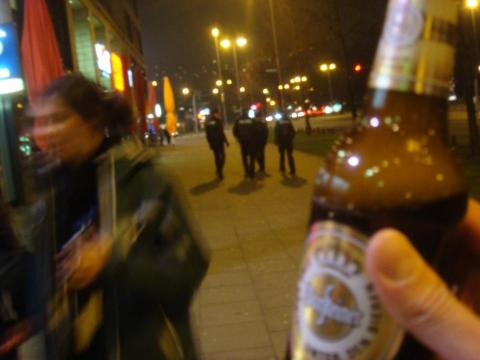 Drinking a beer in front of the po-