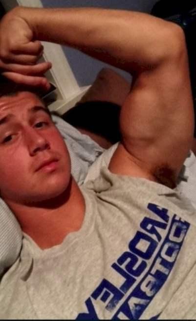 Sexy alpha male flexing buff bulging biceps