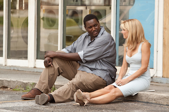 Sandra Bullock and Quinton Aaron star in The Blind Side