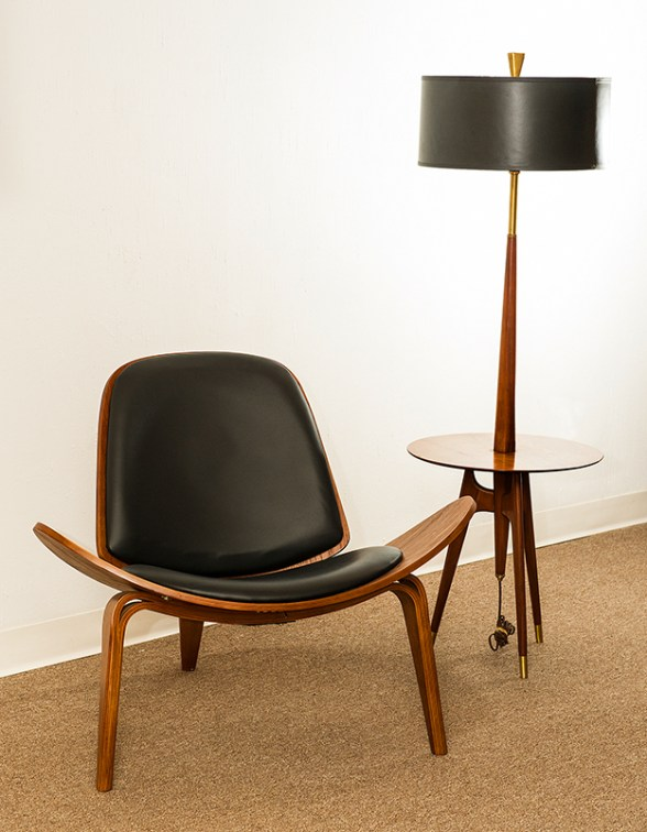 Hans Wegner anniversary chair, $4,000; Rembrandt lamp and table, $900.