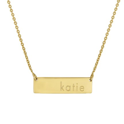 Personalize a gold vermeil DILLON NECKLACE ($68) with her engraved name or an acrylic BALANCE BAR PENDANT ($30) with her initial. Guys N Gals, West Bloomfield (248-851-1260).