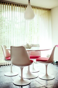 """Designed by Eero Saarinen for Knoll in 1957, the iconic Tulip Chairs and Pedestal Table were """"tested"""" in Cranbrook Academy of Art's Saarinen House, designed by Eero's father Eliel in the late 1920s. Hughet-Hiller picked up the vintage set at an estate sale."""