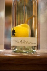One of Black Star Farms' specialties, Pear Brandy, is made by tying a bottle over a budding Bartlett pear branch.
