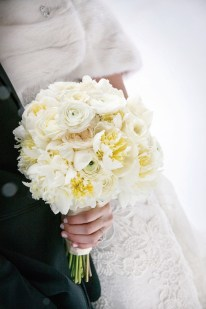The bouquet was a mix of white peonies, ranunculus and white roses.
