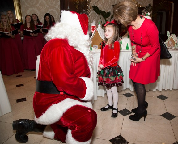 Santa, Mia Carles, 6, of Clarkston with her aunt Lynn Martin of Bloomfield Hills.