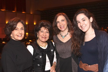 Henrietta Hermelin-Weinberg, Doreen Hermelin, and Wendy and Maddy Hiller enjoy the performance.