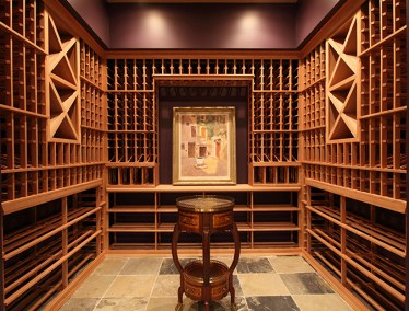 This wine cellar also displays an art collection from behind glass walls.