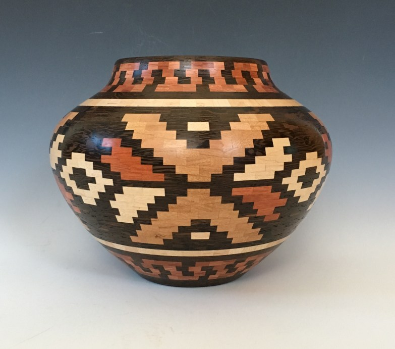 6.25″ x 8″ Made with Maple, Wenge, Cherry, Bubinga and Bloodwood. There are 1608 pieces to this vessel