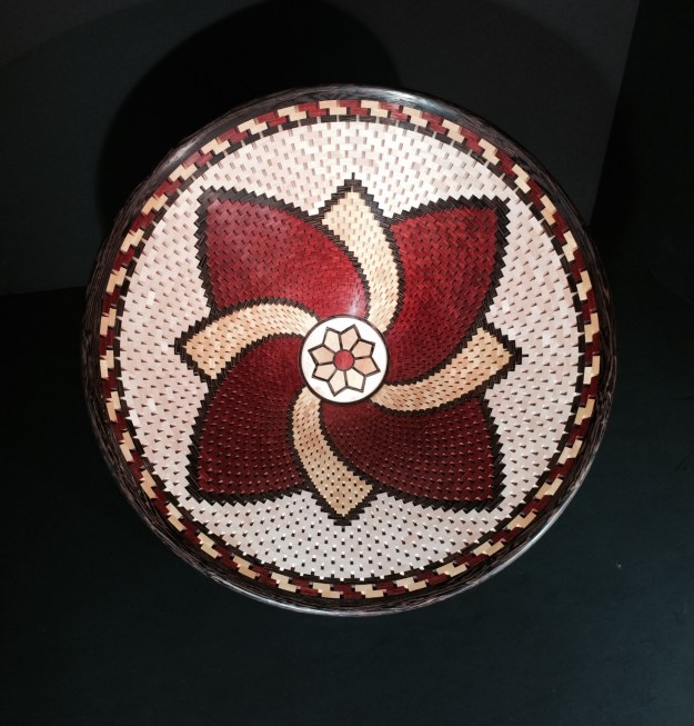"""12"""" x 5"""". Made with Maple, Wenge, Yellowheart and Bloodwood. There are 72 segments per row with a total piece count of 2,555"""