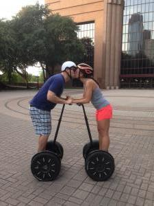 Couple downtown on Segway of Houston tour