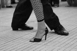 image of feet of two people dancing the tango