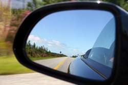 looking back in a rearview mirror