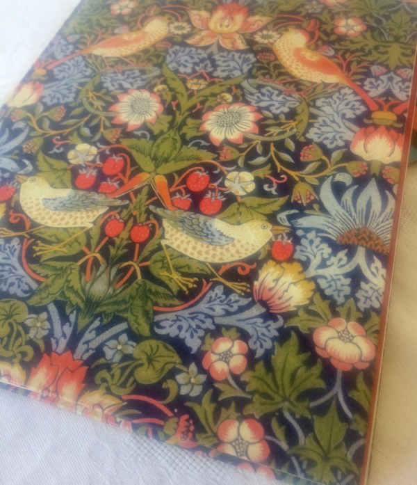 """Strawberry Thief"" furnishing fabric by William Morris - stylised birds, fruit and flowers."