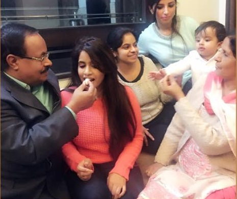 miss pooja family photos father husband sister age