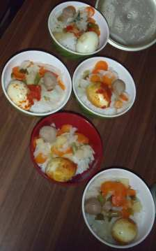 A typical lunch consists of rice, vegetables, a protein - egg, fish or chicken - and sambal