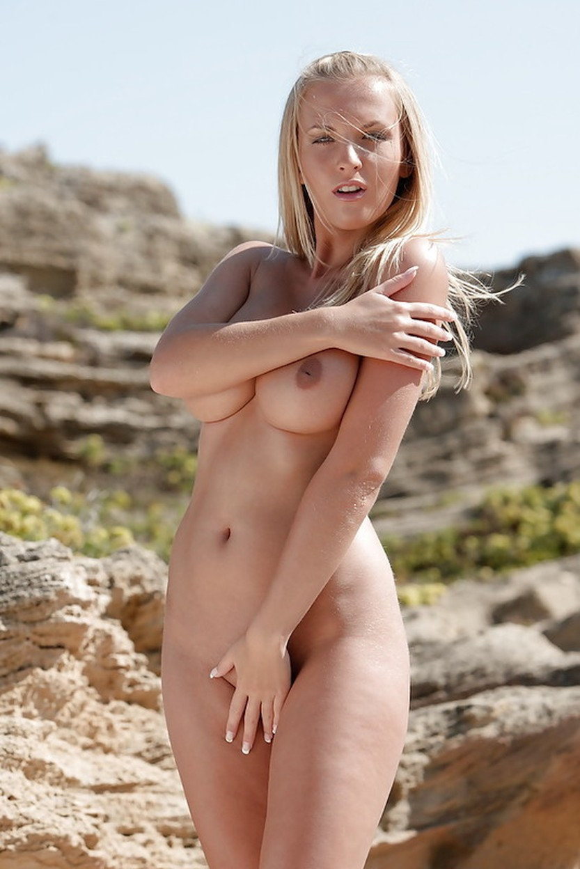 busty-pornstar-spreading-her-legs-in-the-sand-00