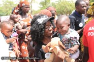 Nikki-Laoye-&-a-cute-baby-all-smiles-as-he-gets-a-toy