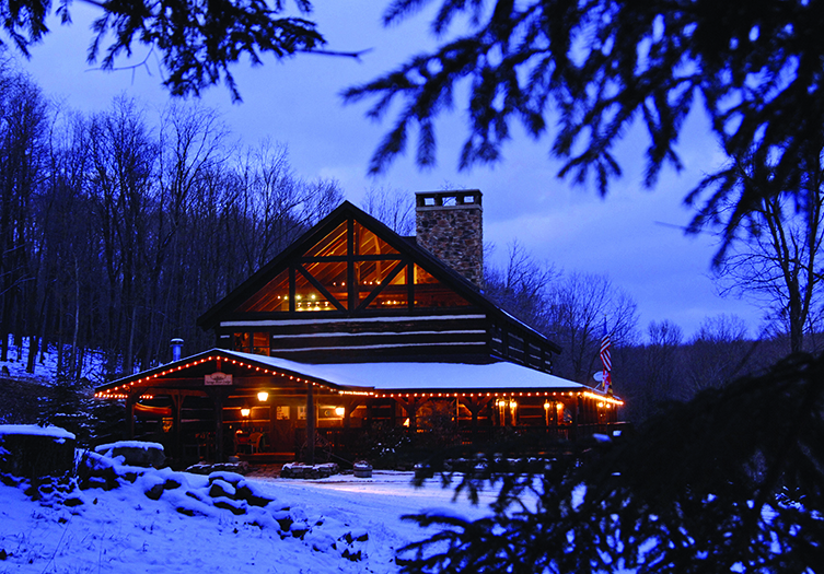 savage river lodge cozy cabin in the snow