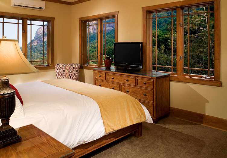 the esmeralda spa bedroom with beautiful neutral colored decor and mountain views