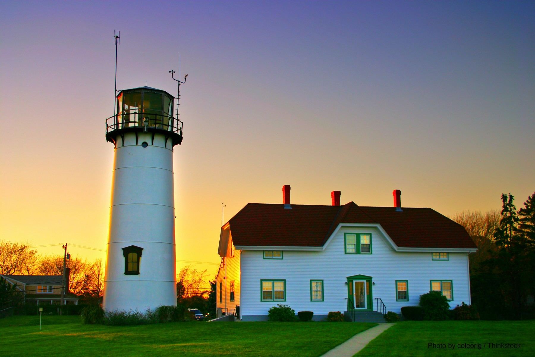 chatham lighthouse with brilliant sunset paining the sky