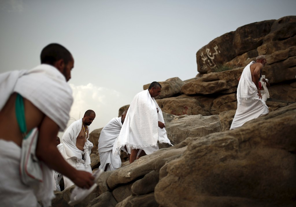Muslim pilgrims climb up on Mount Mercy on the plains of Arafat during the annual haj pilgrimage, outside the holy city of Mecca