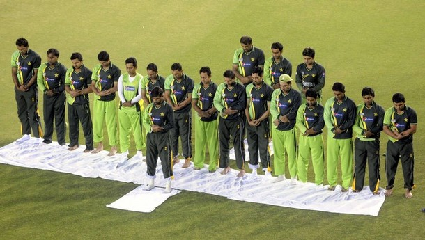 Pakistani team players offer evening prayers before their evening cricket practice session at Punjab Cricket Association Stadium in Mohali March 28, 2011. Pakistan will play their ICC Cricket World Cup semi-final match against India on Wednesday. REUTERS/Stringer (INDIA - Tags: SPORT CRICKET RELIGION)