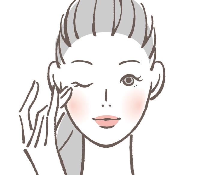 青クマ改善のマッサージをしている女性の画像