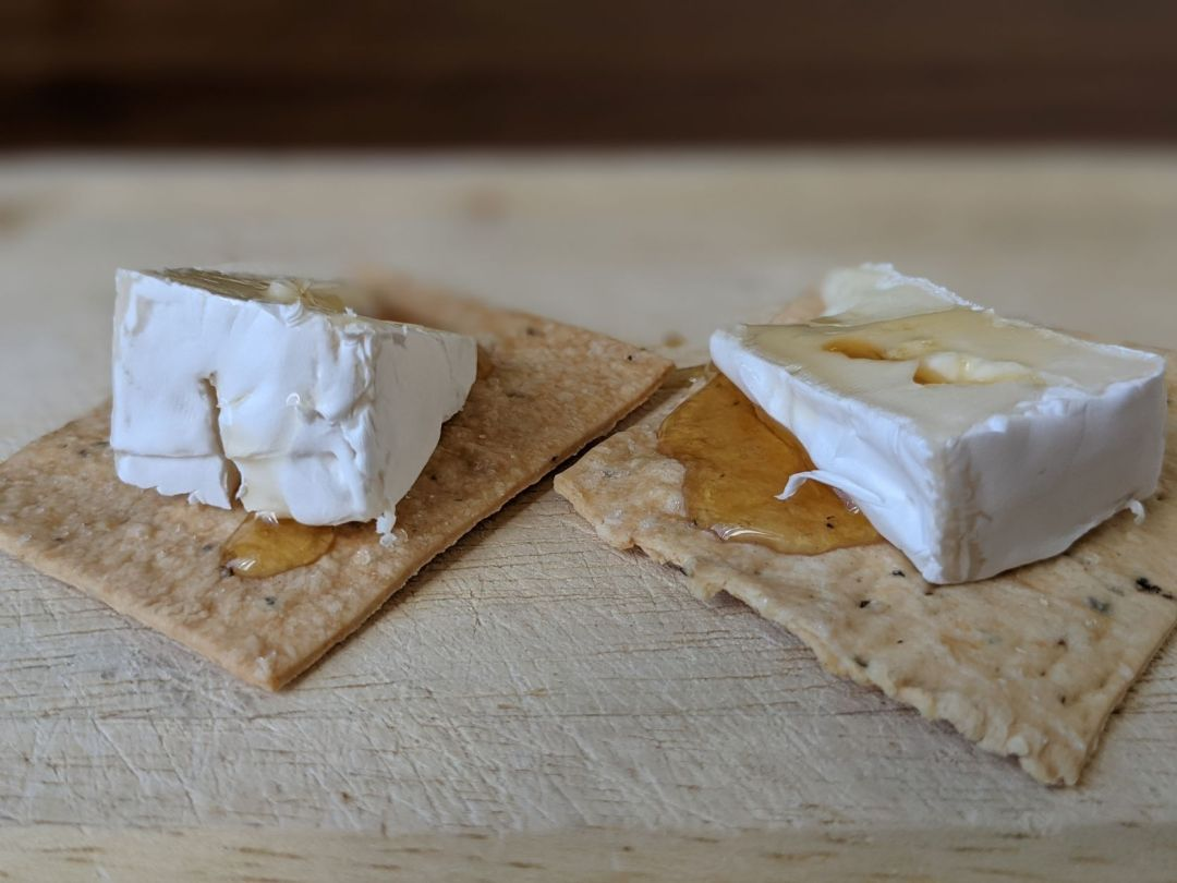 crackers topped with brie and honey