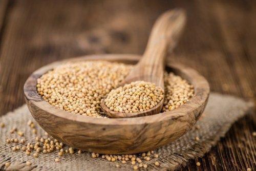 bigstock-mustard-seeds-on-vintage-woode-160168202-min