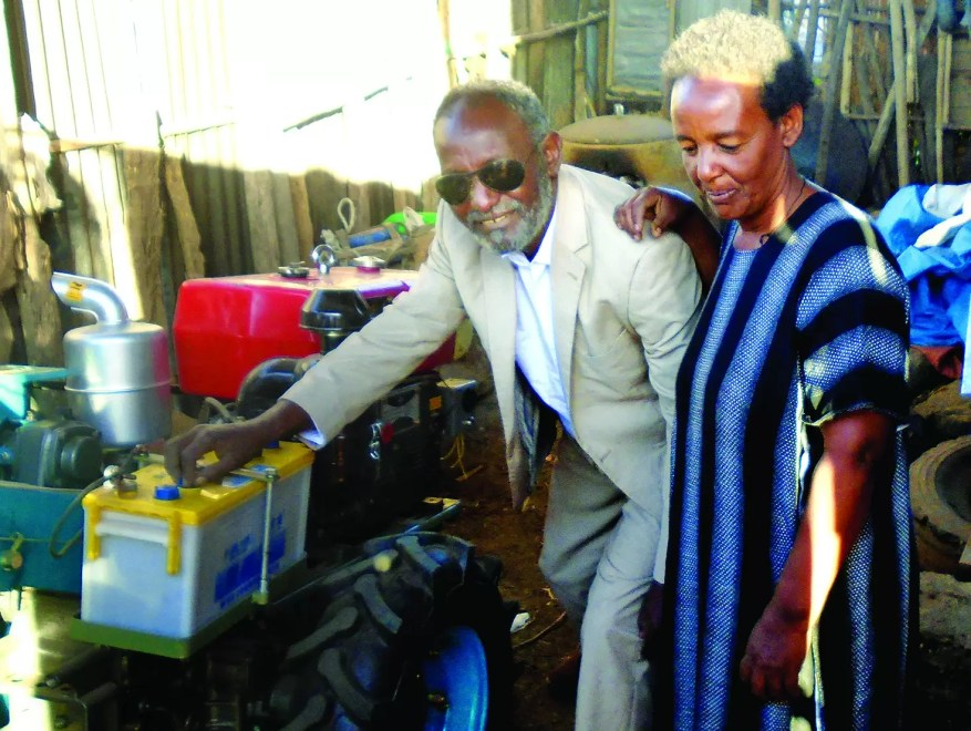Sisay and Kelemeu with their farm equipment
