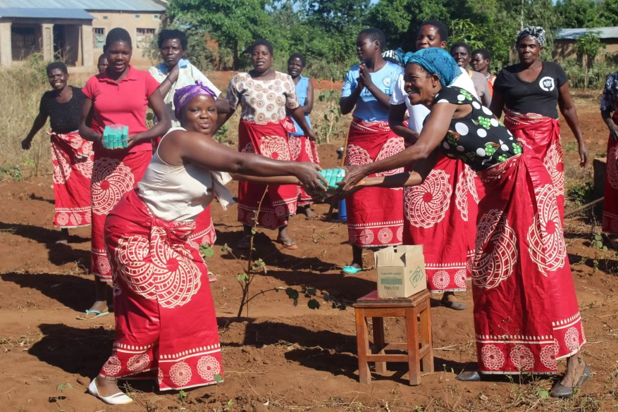 Women in Malawi hand washing