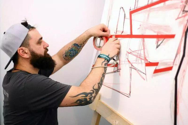 Artist Slava Ostap at work- Making of tape art