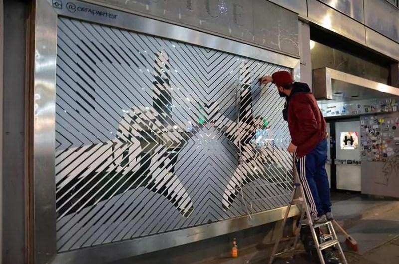 Tape Artist Ostap at Work on the street- The Haus Berlin Art Bang Logo