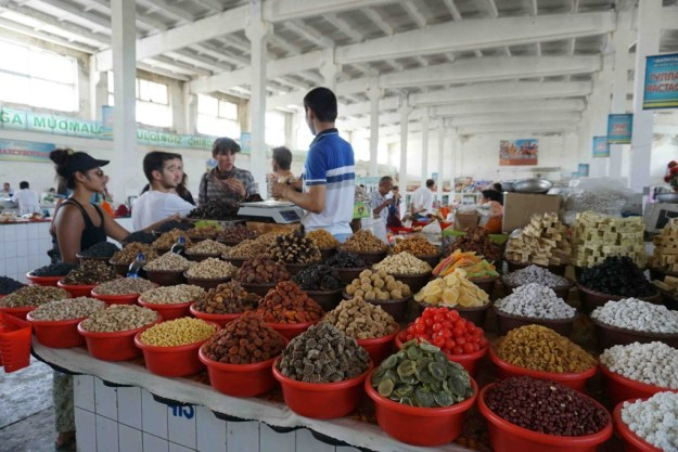Bekh haggling for nuts on our behalf in Bukhara