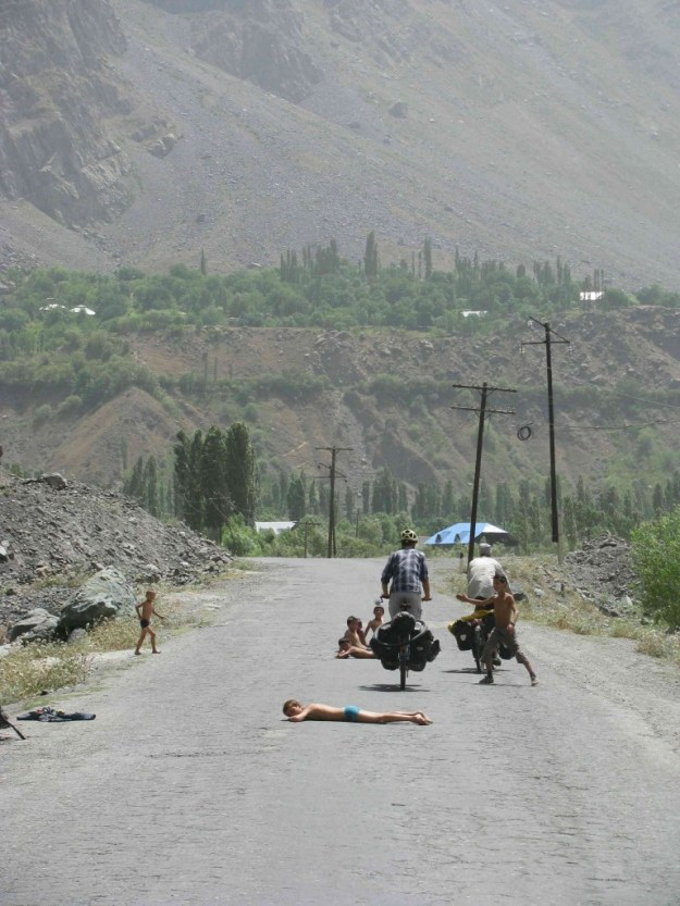 Obstacles take all kinds of unexpected forms in Tajikistan. Wherever there was water, there was usually a pack of bare-ass kids splashing about or drying off. This lot prefered to sun themselves in the middle of the road. Photo credit: R.Holtman