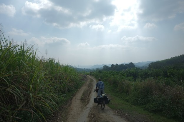 Riding through plantations on the road to the hills, Vietnam. Photo credit: T. Roininen