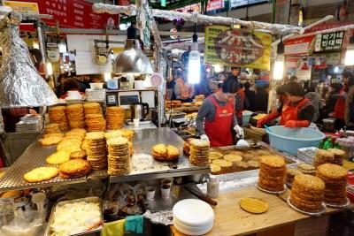 Bindaetteok (thick mungbean pancakes) in Gwangjang Market, Seoul.