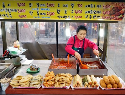 Tteok-bokki, fritters and hotdogs, ubiquitous Korean street food. It's cheaper than chips (but not as nice)!
