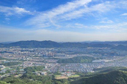 Changwon, the city that absorbed Masan and Jinhae to reach the 1 million population mark to attract regional funding. Masan is just visible on the far right.