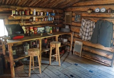 Kitchen of the trapper's cabin in the replica Athabascan village.