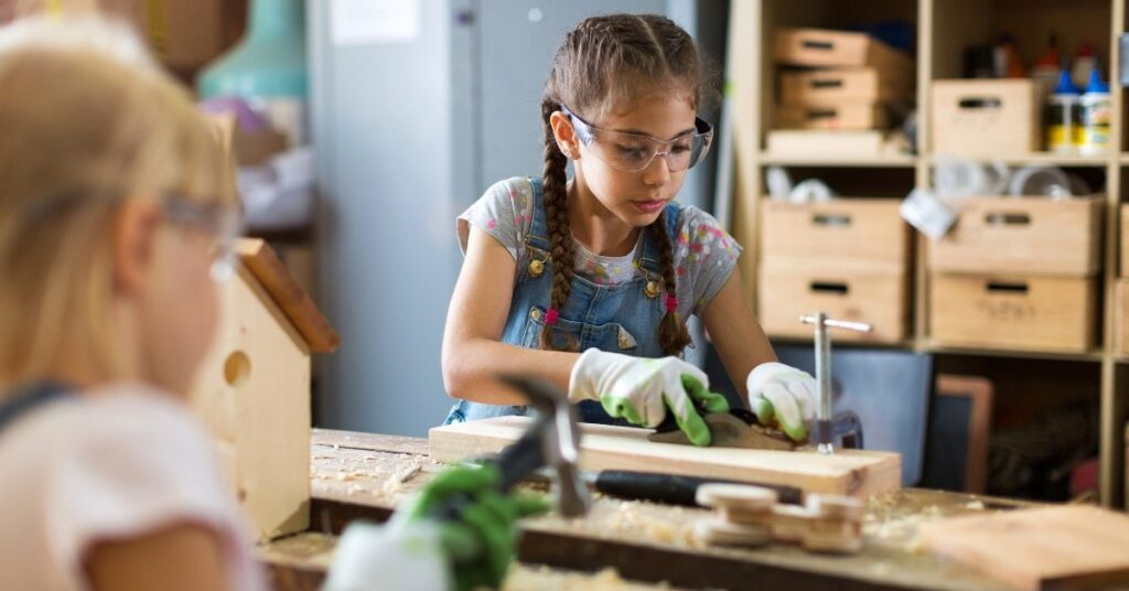 girls woodworking, summer activities for kids