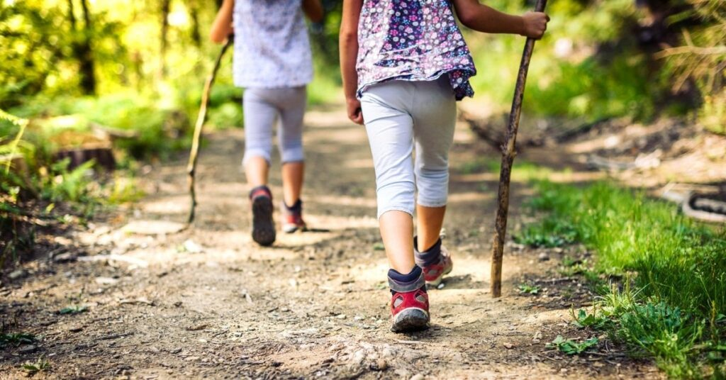 kids going on a hike, free and cheap things to do in the summer with kids